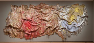 "El Anatsui, ""Gravity and Grace.""  2010, aluminum and copper wire.  145-5/8"" x 441""."
